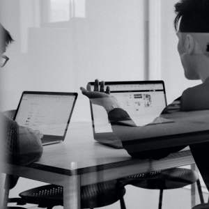 Image of two people in a conference room discussing off page SEO