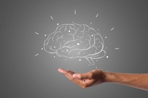 Brain over a cupped hand